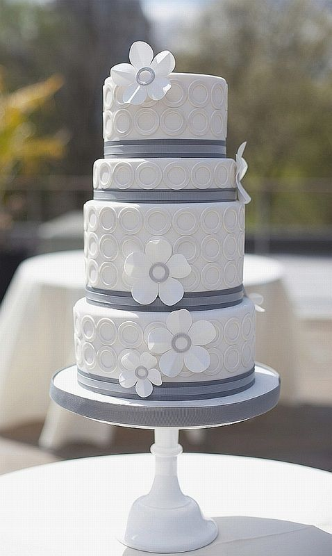 Simple white and grey cake with quilted effect and flowers.
