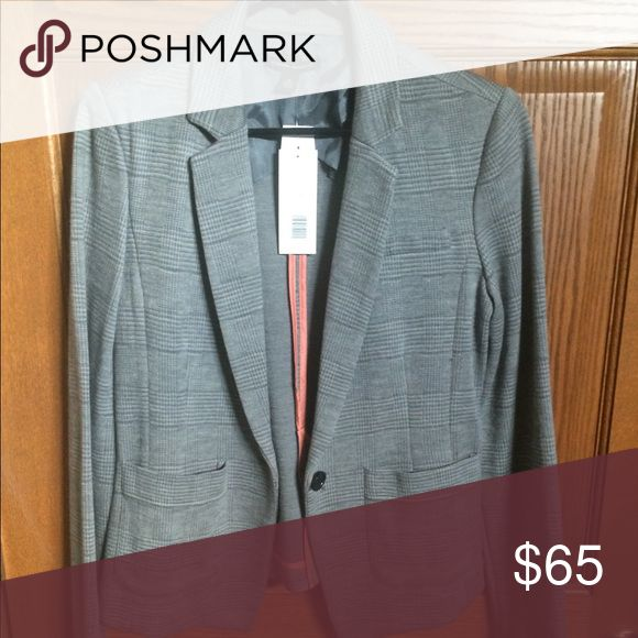 Banana Republic blazer size M NWT Brand new with tags Banana Republic blazer. Grey color. Size 10.  Body is 75% wool and 25% nylon. Trim is 100% acetate. Banana Republic Jackets & Coats Blazers