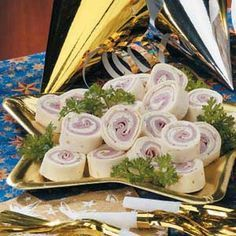 ranch ham rollups - 2pkg cream cheese, 3 chopped green onions, 1 envelope ranch mix. Mix and spread over tortillas, layer with 2-3 slices deli ham, roll and wrap in plastic wrap. Cut before serving