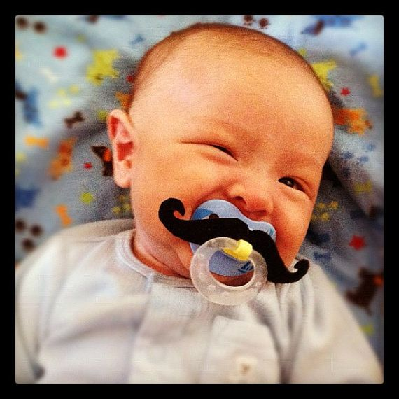 Even though Warren is too old and Dougie doesn't like them I still think this is super funny.  Mustache Pacifier  Black Handlebar by BabyHipsters on Etsy, $9.00