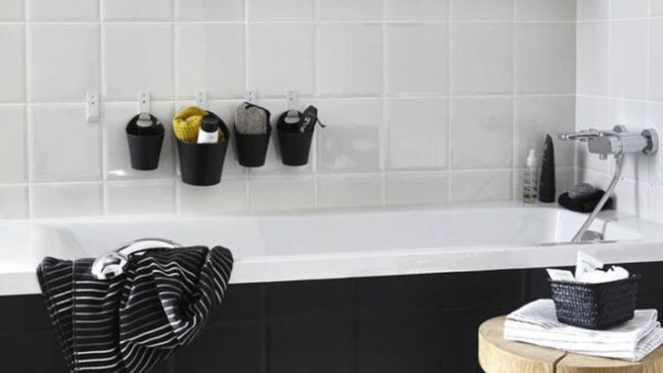 Idée décoration Salle de bain Tendance  Image    Description  Sheathed in oversize ceramic tile, the shower is grounded with a textured river rock floor. A rain-style showerhead and handheld wand enhance showering. The same linear tile on the vanity