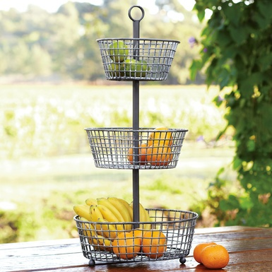 "In France, where you'll find many an epergne (rhymes with ""a fern""), they fill the tiers with the finest produce and flowers of the season. Great for Farmshare produce this summer"