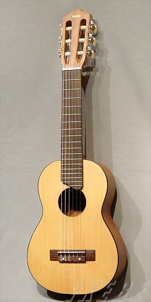 Yamaha Guitalele. This is a fun little travel instrument. I enjoy mine.