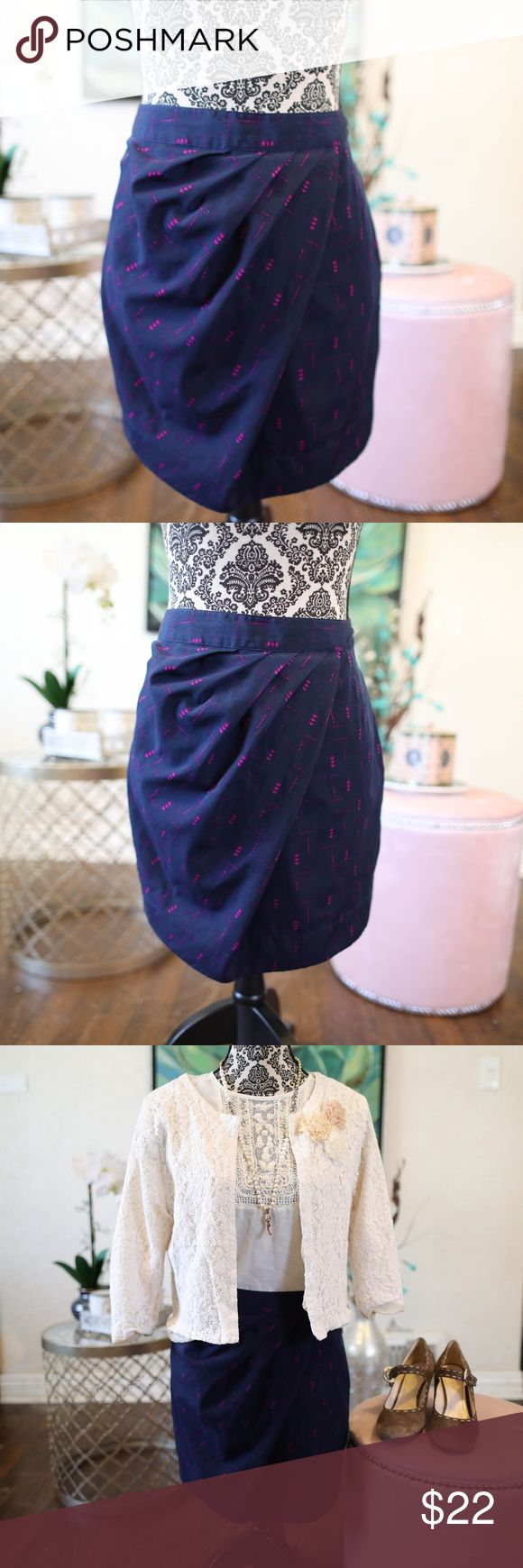 Darling blue skirt by silence and noise This darling blue skirt with pink arrow design and pleats swooping in from the side looks great paired with the twenty one vintage inspired jacket.  100% ployester silence + noise Skirts