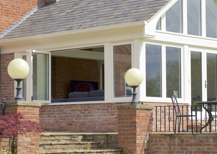 Stunning set of bi-folding windows on one of our garden rooms.