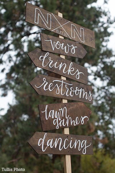 this wooden directional sign is not only cute but useful for directing your guests which way