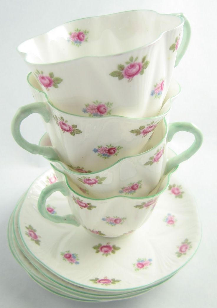 Teacups with pink and green