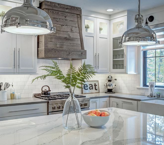 The kitchen hood is a custom hood made from salvaged barnwood