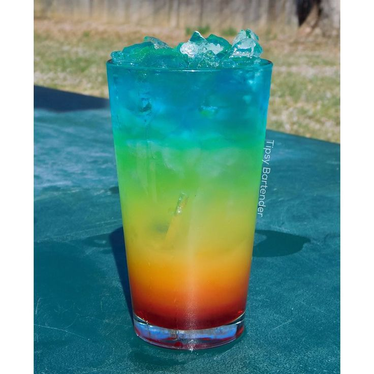 The Perfect Rainbow Cocktail - For more delicious recipes and drinks, visit us here: www.tipsybartender.com
