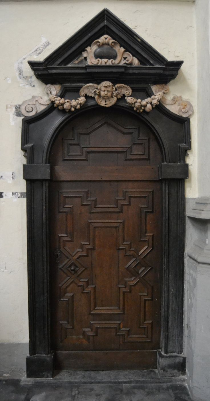 Arched portal doors hand carved wooden door w cherub