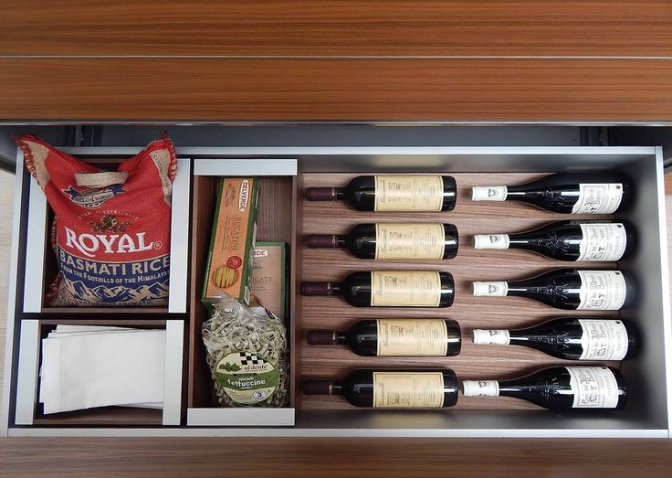 The prism structure of the b3 interior fitting system works perfectly for storing bottles of wine and other goods. The boxes are also designed to fit seamlessly with the V shape of the prism insert. People can change and rearrange the drawer organization at-will. www.bulthaup.com #bulthaup #kitchens #modernkitchens