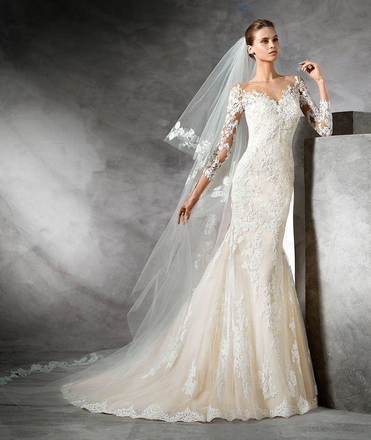 Spectacular fit and flare wedding dress that flares out at the bottom. It has 3/4 sleeves with gorgeous floral lace and guipure motifs all over the body of this romantic dress. Simply marvelous!
