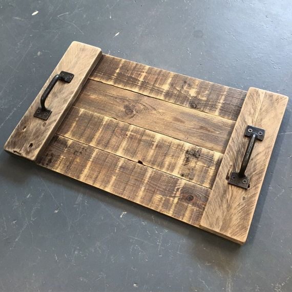 Carry things in true rustic style on this Caisley Co branded pallet wood serving tray with cast iron handles.  Approximate dimensions; Length 50cm