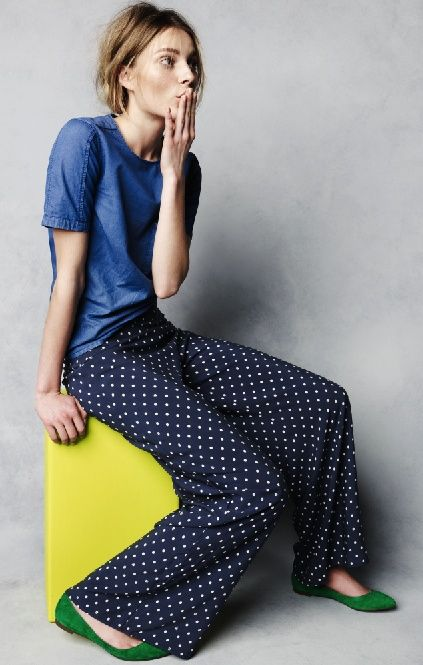 Shop this look on Lookastic:  https://lookastic.com/women/looks/blue-denim-crew-neck-t-shirt-navy-and-white-polka-dot-wide-leg-pants-green-suede-ballerina-shoes/9728  — Blue Denim Crew-neck T-shirt  — Navy and White Polka Dot Wide Leg Pants  — Green Suede Ballerina Shoes