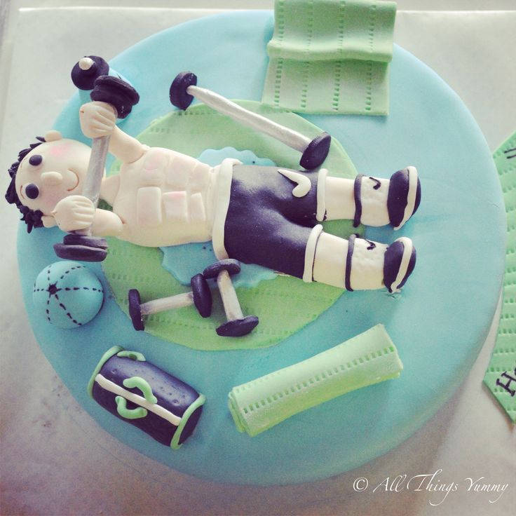 Birthday Cakes for Boys - Pastel Blue Fondant Cake for a Gym Freak with Gym Equipments | All Things Yummy #Sweating it out at the #gym!! #dumbbell #workout #gymbag #yogamat #ball #waterbottle #benchpress #socks #shoes #boy #weights #workingout #atyummy #cake #gymtheme #fitnessfreak