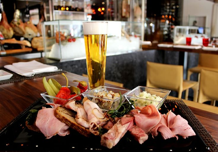 Bohemian Misto Board with pickled vegetable and beer bread; Black pork ham, Prague ham, speck, smoked bacon and tlačenka