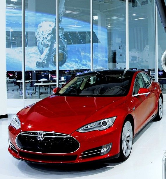 It doesn't snarl like a Lamborghini, but Tesla's new Model S is no eat-your-broccoli all-electric car, says Dan Neil—more like eat-up-the-pavement-while-grinning-ear-to-ear. This vehicle should probably come equipped with a lawyer. You're going to need one.