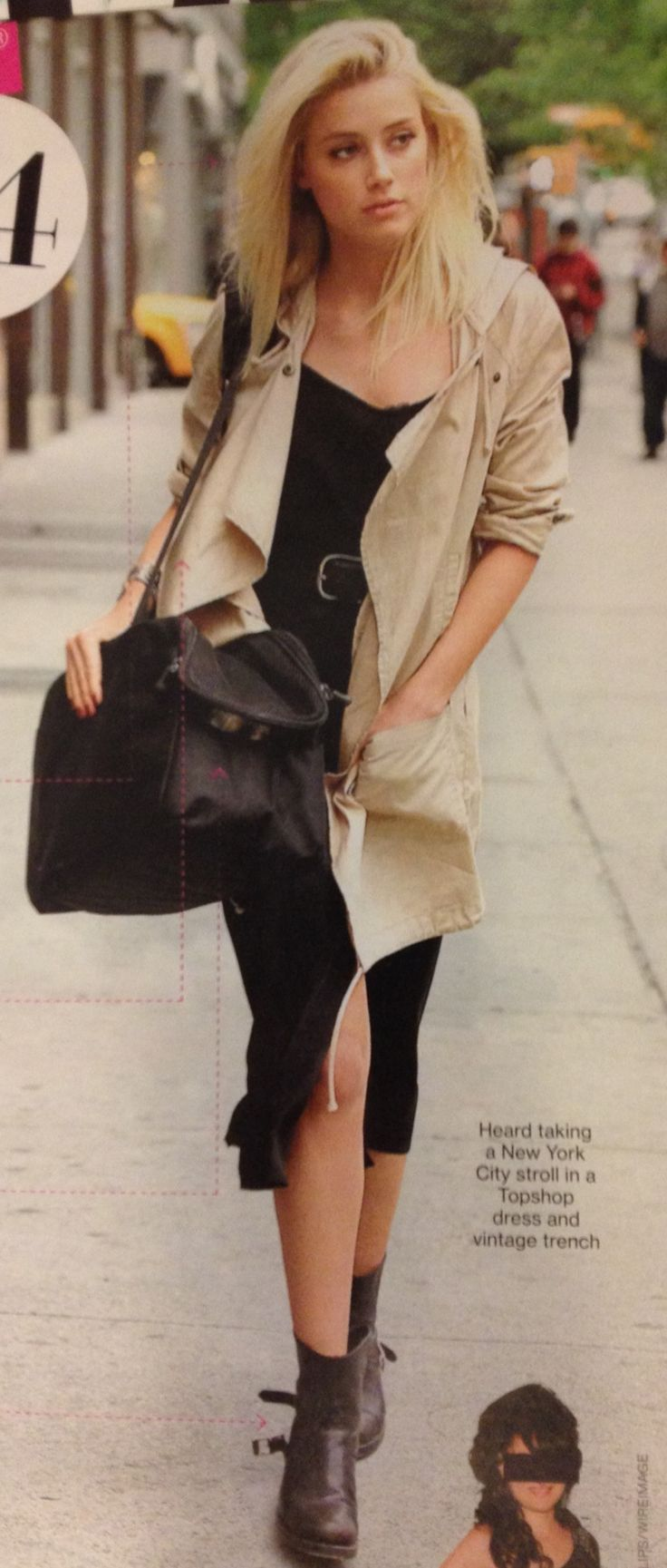 Amber Heard in classic black slip dress with slits, a khaki trench, big buckled belt, and chunky moto boots.