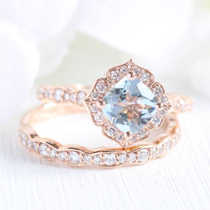 This unique bridal ring set showcases a vintage floral aquamarine engagement rin…