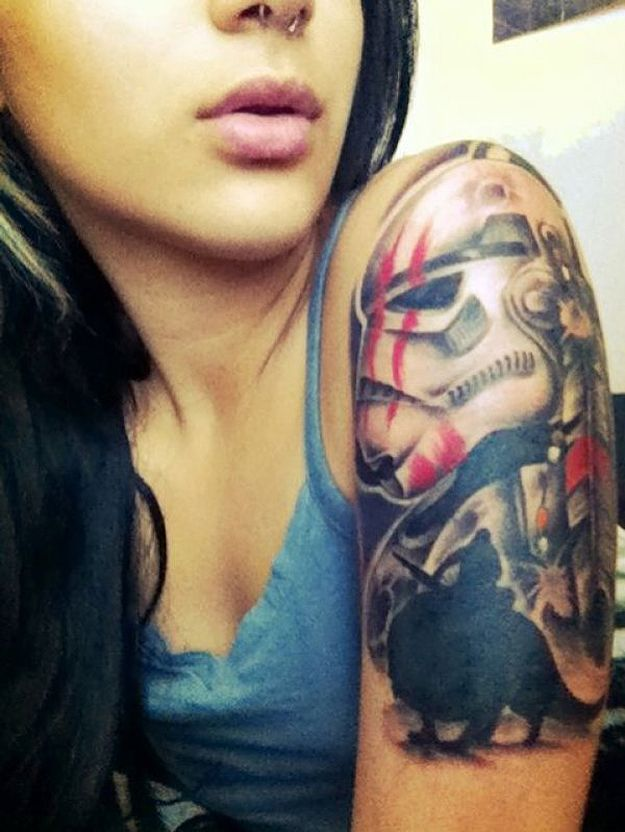 I like the Dewback silhoutte at the bottom of this Star Wars tattoo.