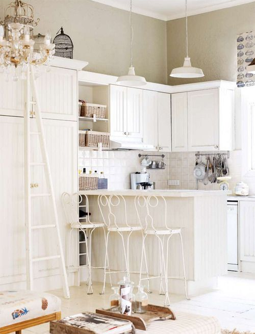 Oh man, this kitchen is way cute. Those barstools are my favorite.