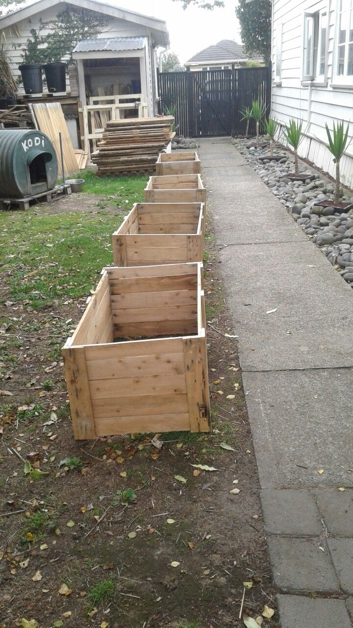 The beginning of the raised garden beds made out of used pallets and pallets lids