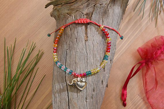 Check out this item in my Etsy shop https://www.etsy.com/listing/526940259/colorful-beaded-love-charm-bracelet