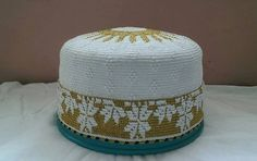 flower design with sun top bohra white golden topi