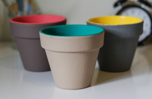 Painted Planters  ........................................Time: 1 hour, including dry time...........................Materials: clay planter, paint, pva, glitter, brush, plant