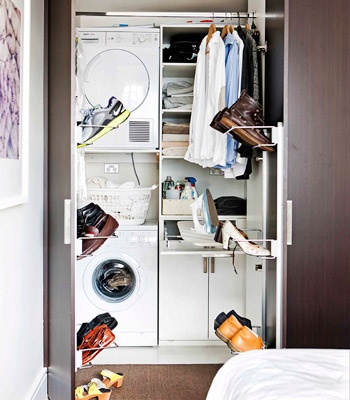 A hanging area has been incorporated in the concealed laundry where the warm, dry air from the condenser dryer helps dry the shirts. In the linen cupboard, next to the washer and dryer, a pull-out ironing board and ironing station have been installed