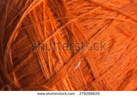 Closeup ball of wool in orange color