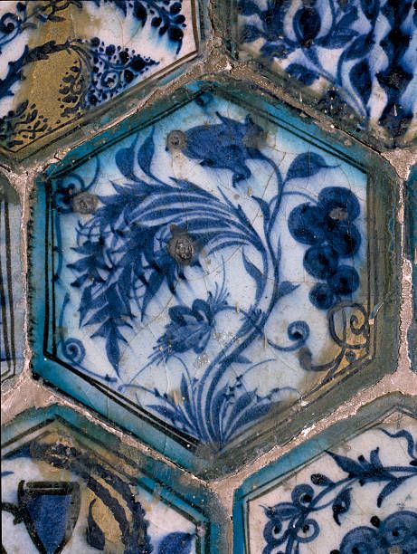 Mismatched Iznik style tiles from a wall panel, Exported to Cairo these tiles are a prime example of the ceramic wares produced by the Ottoman artists. Detail. Turkey. Islamic. 17th c . Iznik.