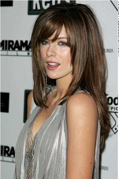 This straight hairstyle is sexy and chic. Kate Beckinsale's long hair falls beautifully down her back with bangs on the forehead. The hair frames her face nicely.Kate Beckinsale's haircut is very long which has been layered as well.Her hair colour is a rich warm shade with highlights.