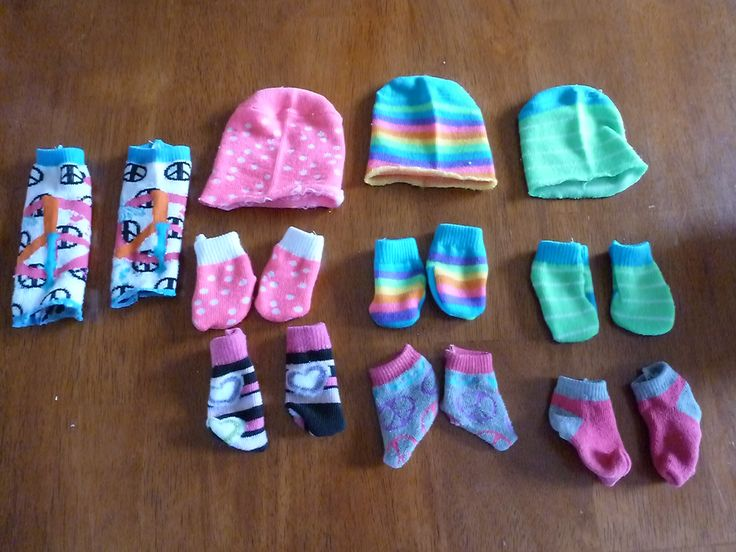 Made from old miss-matched socks with holes. One sock makes two doll socks and a hat or one pair of leg warmers.
