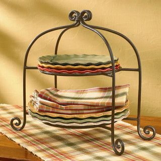 scrolled iron plate rack with footed detail is both stylish and functional pair it up