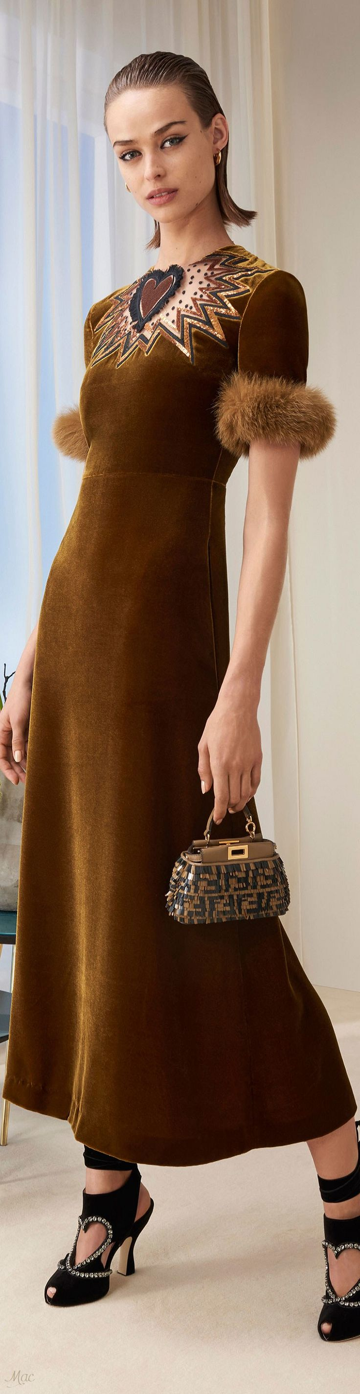 Pre-Fall 2018 Fendi Velvet will never go out of style. We are loving this caramel colored dress with furry trim and sequined designs. Update an old look with similar trim.