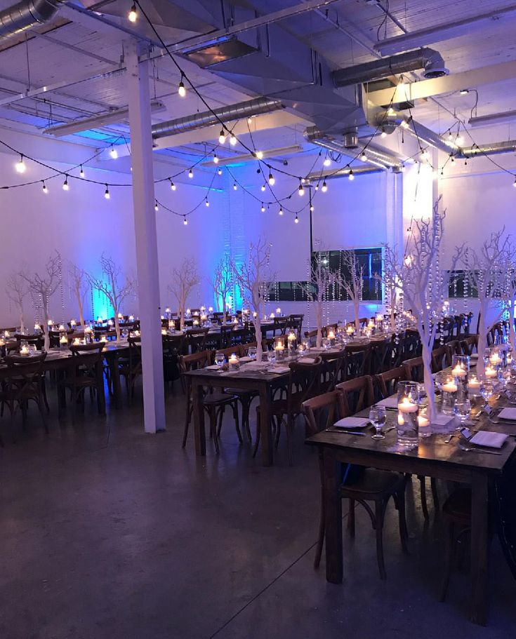 Beautiful Winter Wonderland event with white trees, crystals, snow, lots of candles and string lights! By R5 Event Design