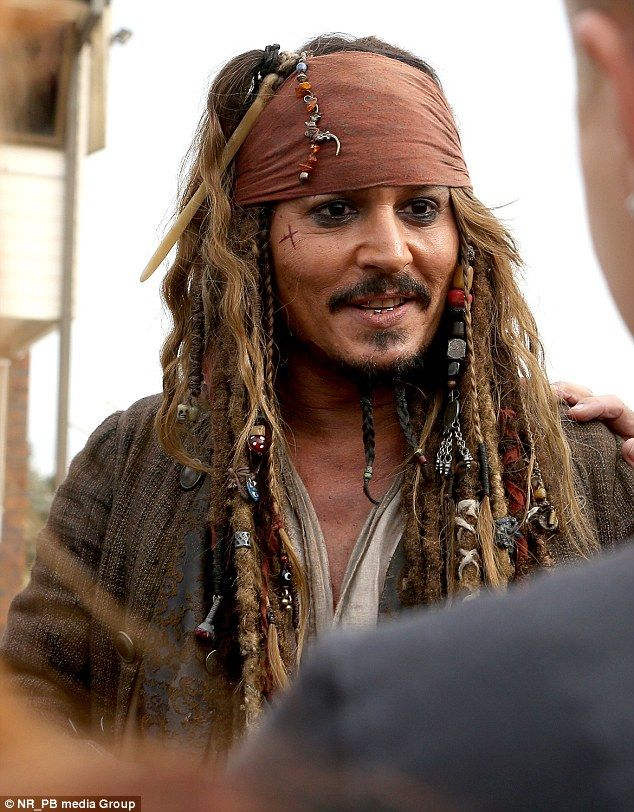 Man of the people: Earlier on Wednesday, Johnny met with fans while in full Captain Jack Sparrow costume