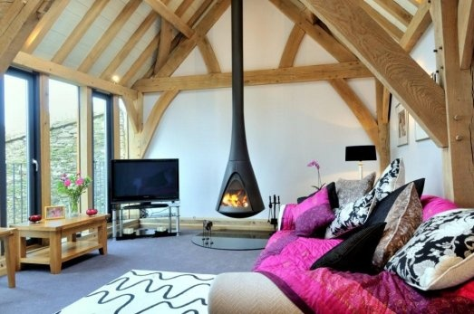 Suspended woodburning stove in barn room