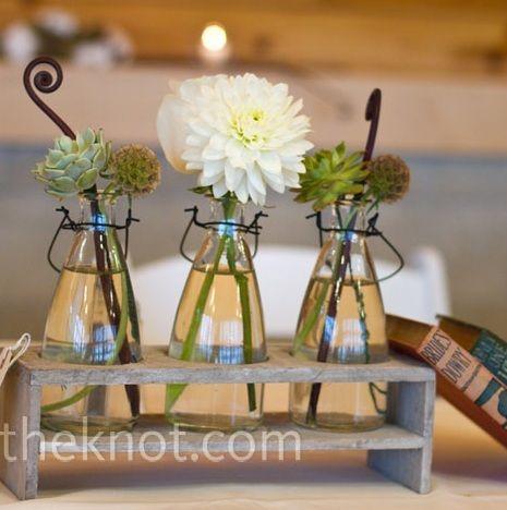 Succulents in glass bottles wedding center piece for Glass bottle centerpieces