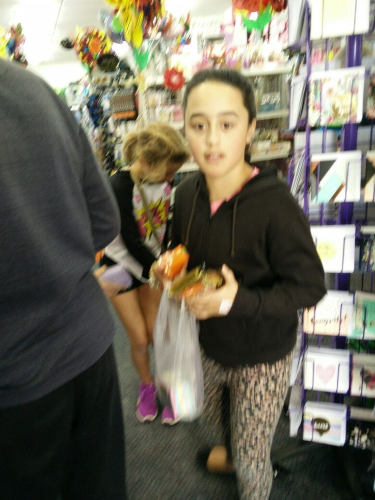 A young girl shopping at the Family Market in Orewa