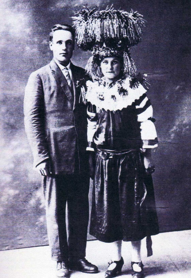 A Finnish bridal couple 1925. This bride has a very high crown so she was probably from a well to do family. Poor ones made their crown sometimes from gold coloured paper and decorated it with coloured beads and pieces of broken mirrors.