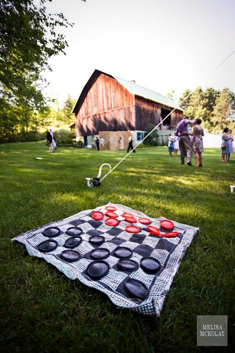 Big checker board for lawn games  The Awesometastic Bridal Blog Rehearsal Dinner Yard Games