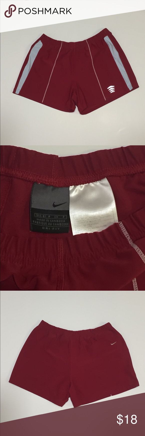 Red Nike Women's Dri Fit Athletic Shorts Great pair of shirts! Deep bright red and white with gold embroidered swoosh! Back zippered pocket. 12 1/2 waist relaxed.  12 length. Nike Shorts