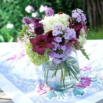 A collection of garden-fresh flowers makes a budget-friendly centerpiece. Find more wedding centerpiece ideas: http://www.bhg.com/wedding/flowers/wedding-centerpiece-ideas/?socsrc=bhgpin080112countryweddingbouquet#page=10