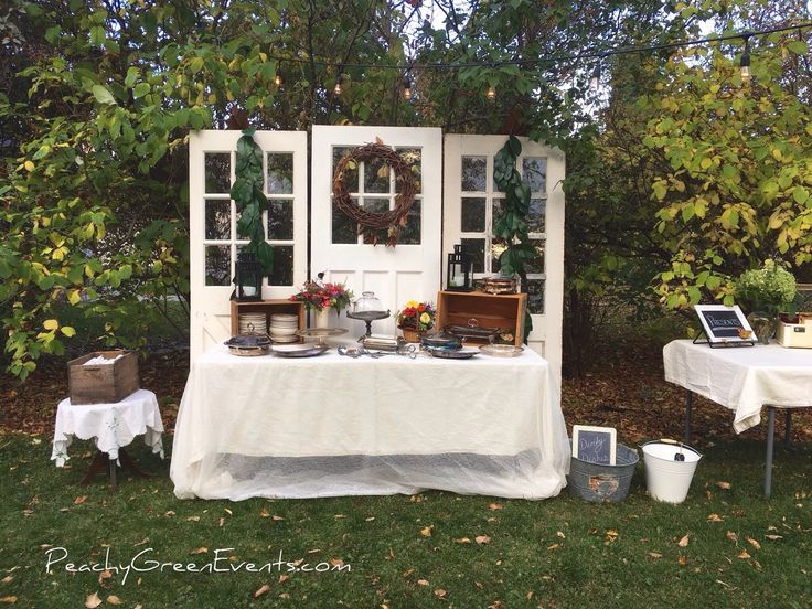 Outdoor Appetizer Buffet, 50th Wedding Anniversary with Vintage Door Backdrop and String Lighting