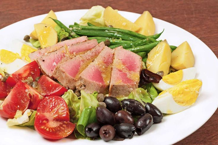 Salade Niçoise with Pan-Seared Tuna: Served as a main course, our version of Salade Niçoise is made with pan-seared tuna steaks, hard-cooked eggs, potatoes, green beans, lettuce, tomatoes, olives and capers.