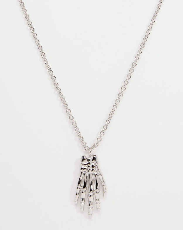 This necklace which gives a subtle nod to their emo inclination.