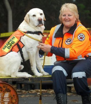 River to the rescue: Julie Cowan from Search and Rescue Dogs Australia with her seven-year-old Labrador River.