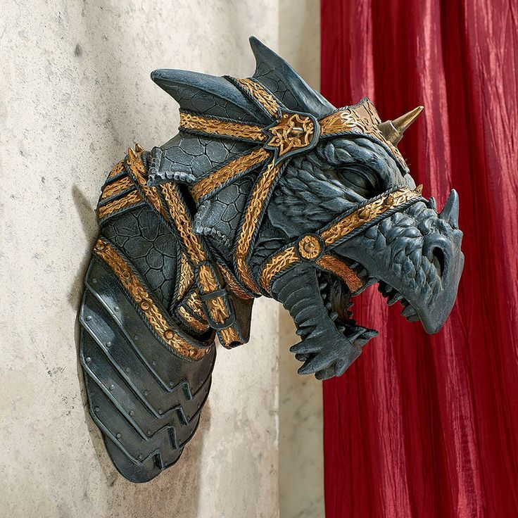 War Dragon Wall Statue - By Artist Monte M. Moore. Emerging a full 7 inches from your wall, this screaming War Dragon strikes a powerful presence on your wall as a strong warrior beast! Cast in qualit